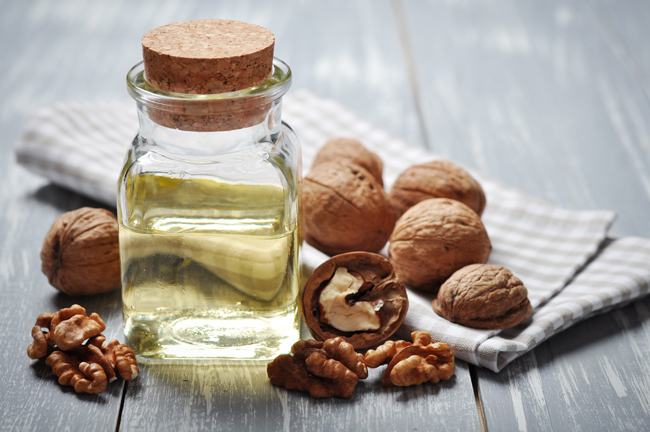 Walnut oil shows great promise as a non-GMO alternative for homemade diets. However, there are risks to substituting it for corn oil at this time.